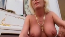 Mature Blonde Is Gently Squeezing Her Big Tits With A Vibrator Until Her Lover Cums