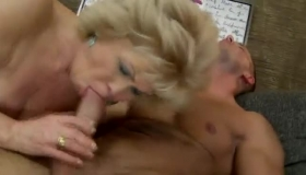 Mature Granny On Red Satin Stockings Is Sucking And Riding A Big, Black Cock Like Crazy