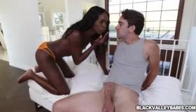 Black Darling, Ana Foxxx Is Kneeling On The Floor And Sucking Her Boyfriend's Huge Cock