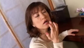 A Mature Japanese Babe Sucking