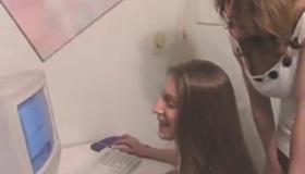 Girl And Computer In A Lesbian Action