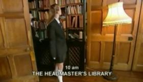 Two Naughty Schoolgirls Kneeling On The Floor