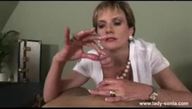 Lady Sonia Is Passionately Sucking Her Partner's Rock Hard Dick, While Kneeling In Front Of Him