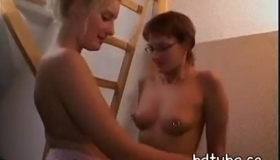 Two Blonde Ladies Sucking On The Same Old Hard Cock