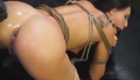 Chained Babe Enjoys Double Penetration