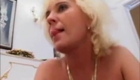 Mature Blonde Is Playing With Her Big Tits In The Bathroom While No One Is Watching Her