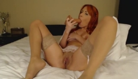 Sexy Redhead Girl Riding The Pole