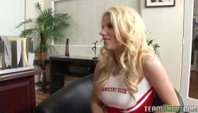 A Busty Cheerleader Playing With Her Pussy