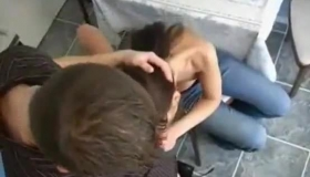 Hot Brunette Is Getting Forced To Suck A Big, Black Cock, While Kneeling On The Floor