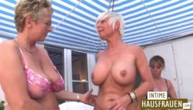 Stunning Lesbos Shoving Their Dildo Into Each Others Boobs