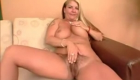 Blonde Babe With Hairy Pussy Sucks A Power Toy And Gets Her Pussy Pised By The Addiction