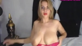 Big Titted Milf Is Masturbating While Lying On The Bed, With Bent Legs, Because It Excites Her